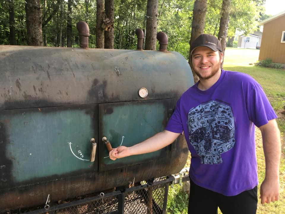 This is my son Josh with our homemade smoker