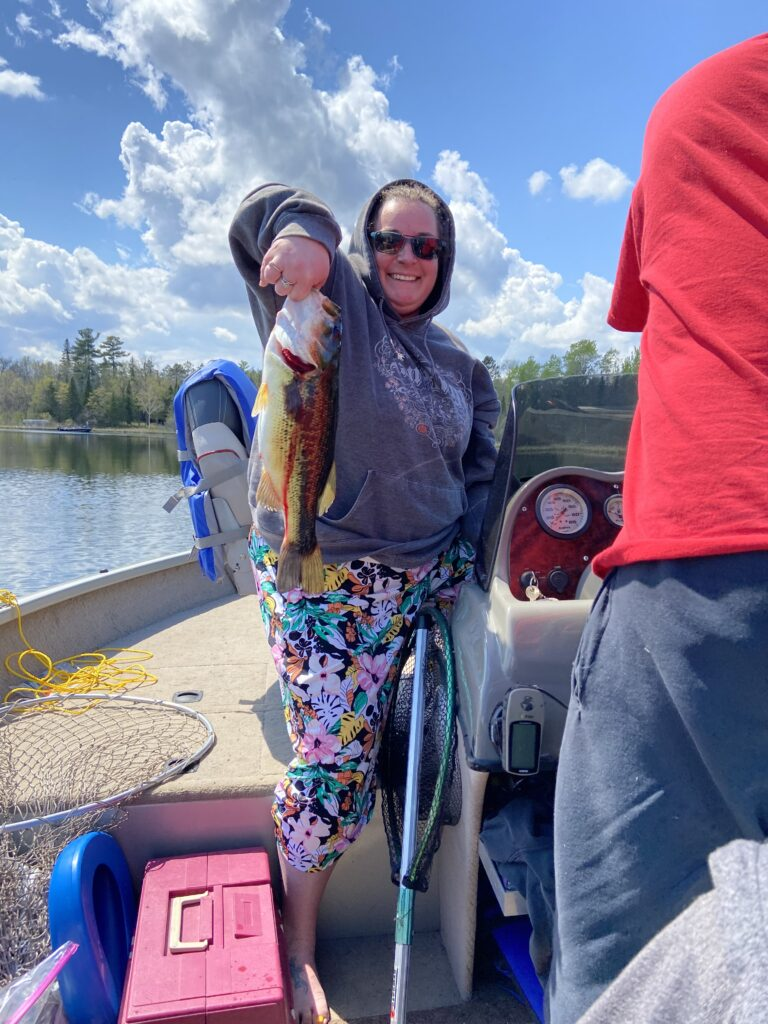Kelly Sparby catching fish on woman lake