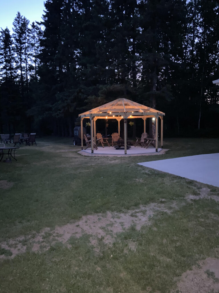 octagon gazebo with lights on at night