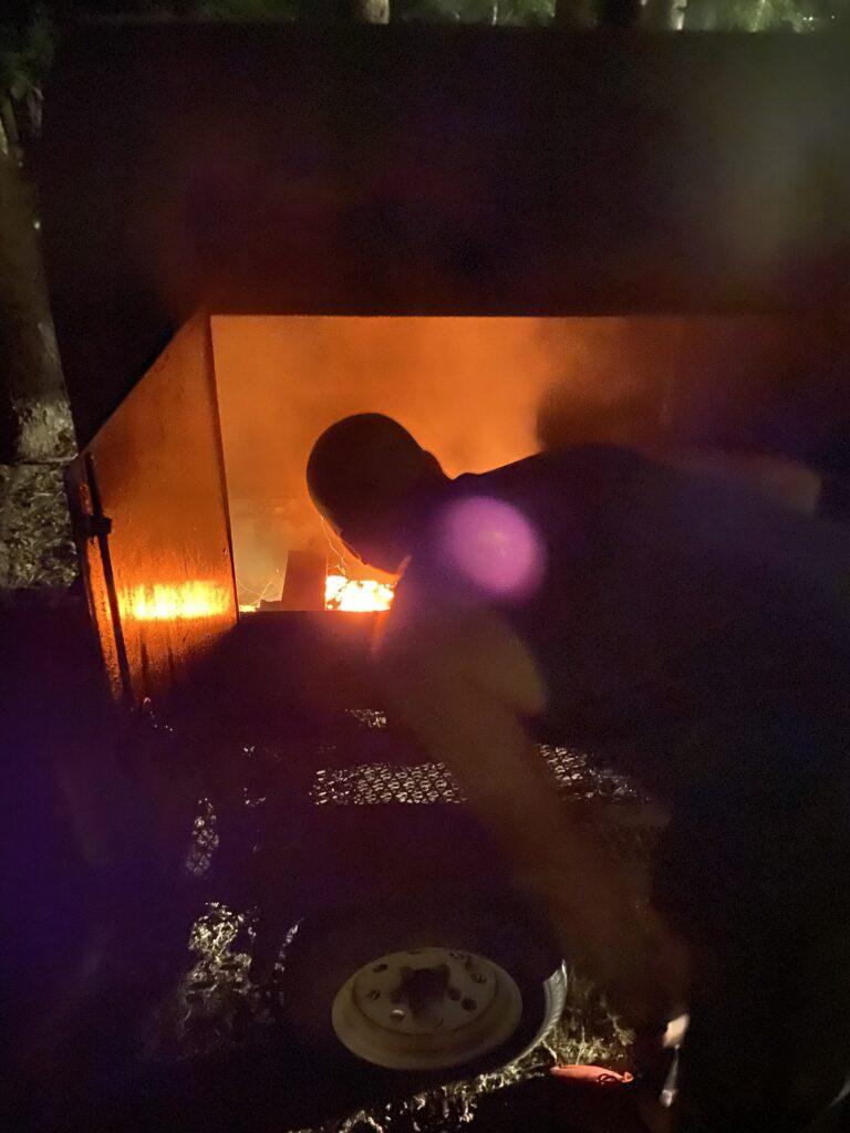 Josh fireing up the smoker