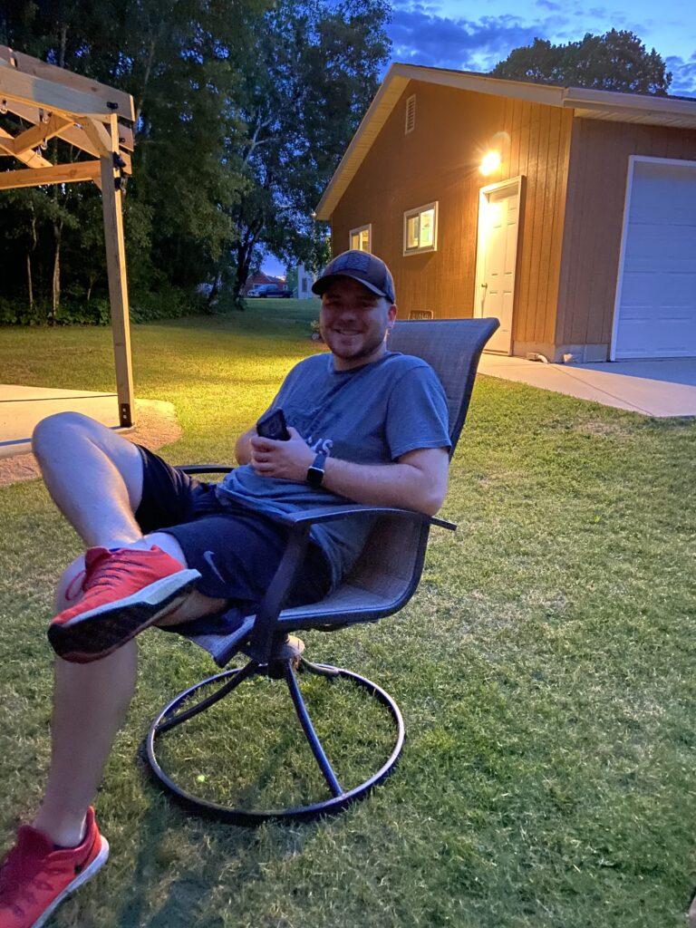 josh relaxing while smoking meat