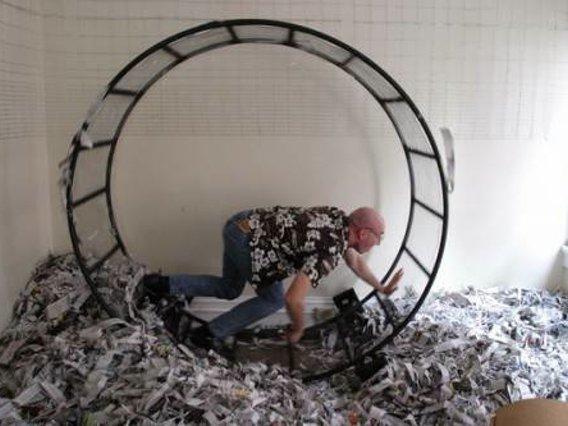 human running in circles on hamster wheel